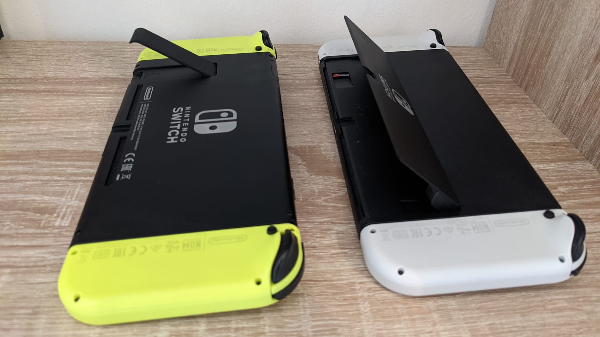Nintendo Switch OLED compared to old Switch kickstand
