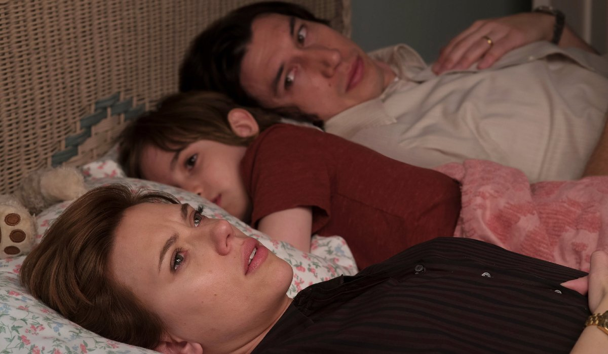 Marriage Story Scarlet Johansson and Adam Driver separated in bed by a child
