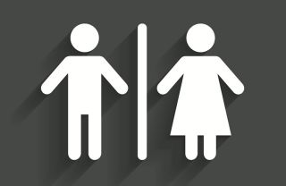 A sign indicates men's and women's bathrooms