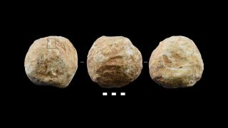 Different sides of a prehistoric stone crafted ball found at Qesem Cave in Israel.