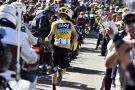 Chris Froome runs towards Chalet Reynard after an incident with a television motorbike on Stage 12 of the 2016 Tour de France