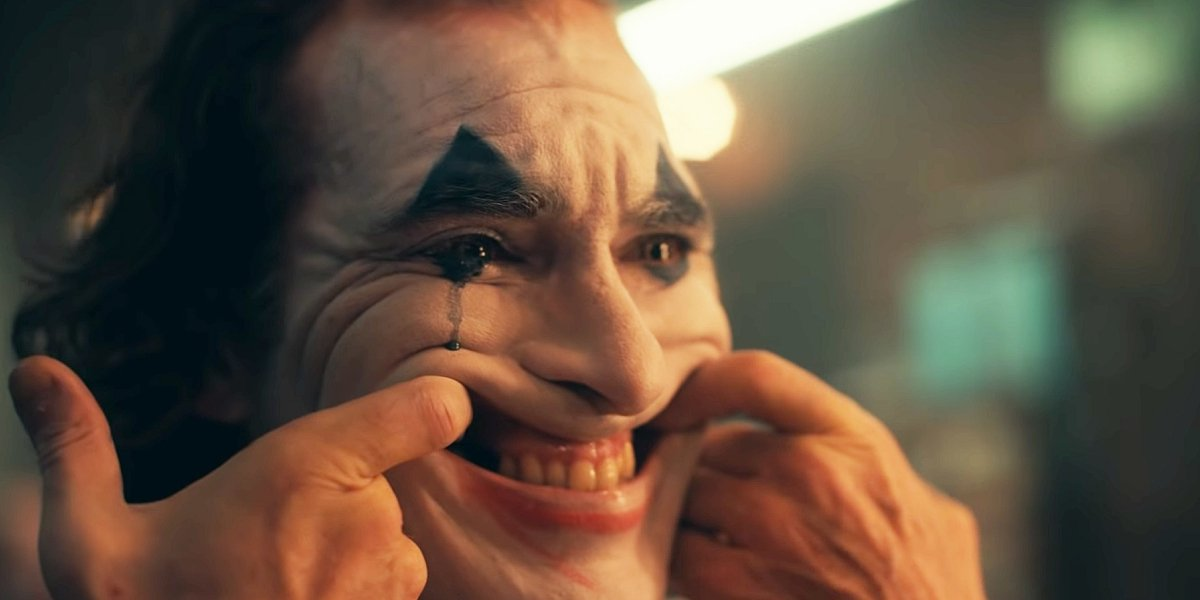 Joaquin Phoenix tries to put on a happy face in Joker