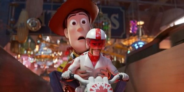 tom hank's woody and keanu reeve's duke caboom doing a motorcycle stunt jump in toy story 4
