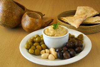 Hummus and olives on a plate