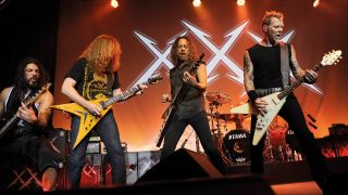 A photograph of Metallica on stage with Dave Mustaine