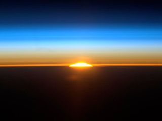 International Space Station image of one of 16 sunrises