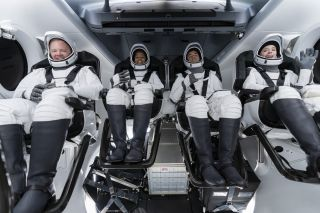 The Inspiration4 crew are pictured inside a SpaceX Crew Dragon capsule on Sept. 12, 2021, during a dress rehearsal for their Sept. 15 launch. From left: Chris Sembroski, Sian Proctor, Jared Isaacman and Hayley Arceneaux.