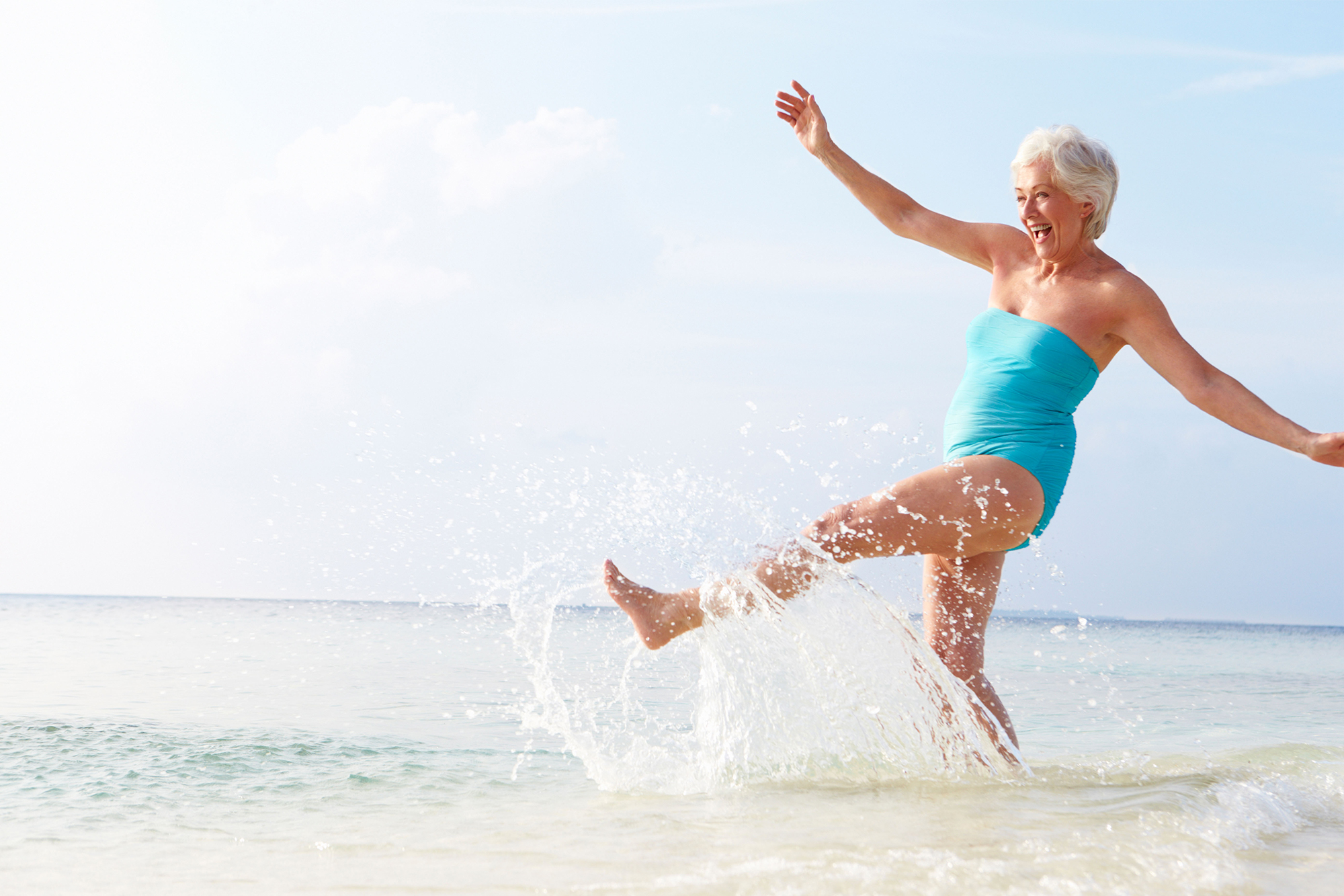 Over 60s travel - Woman on beach holiday