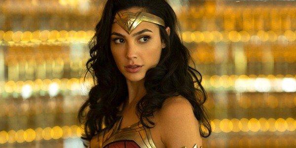 Gal Gadot as Diana Prince Wonder Woman 1984 gold background photo Warner Bros. DC