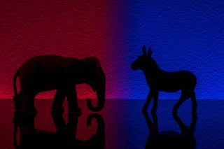 Democrats vs republicans are facing off in a ideological duel on blue and red backgrounds. I