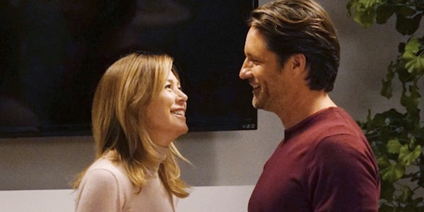 Meredith and Riggs smiling at each other