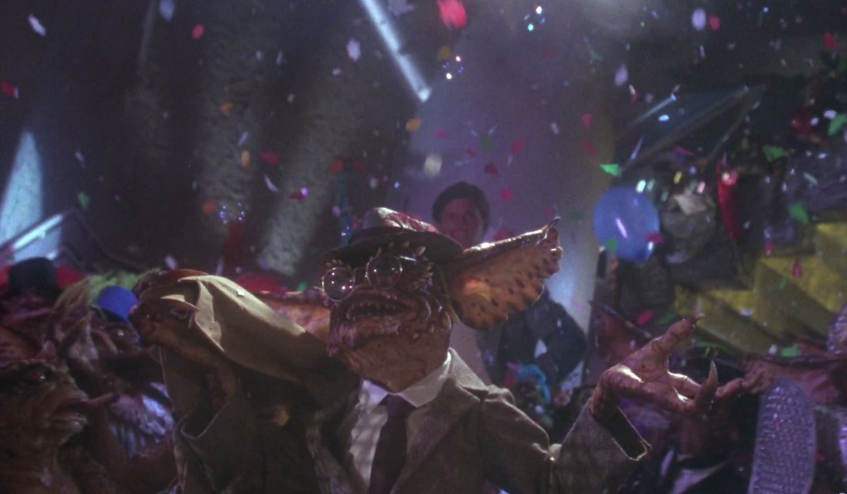 Gremlins 2: The New Batch Brain Gremlin holding court in a musical number
