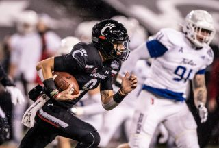 Desmond Ridder of the Cincinnati Bearcats will take on Georgia in the Peach Bowl on New Year's Day.
