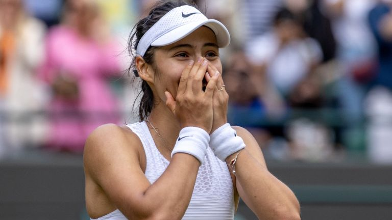 Emma Raducanu of Great Britain celebrates match point during her Ladies' Singles third Round match against Sorana Cirstea of Romania during Day Six of The Championships - Wimbledon 2021