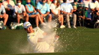 Hideki Matsuyama of Japan plays a shot from a bunker on the 18th hole during the final round of the Masters at Augusta National Golf Club on April 11, 2021 in Augusta, Georgia.