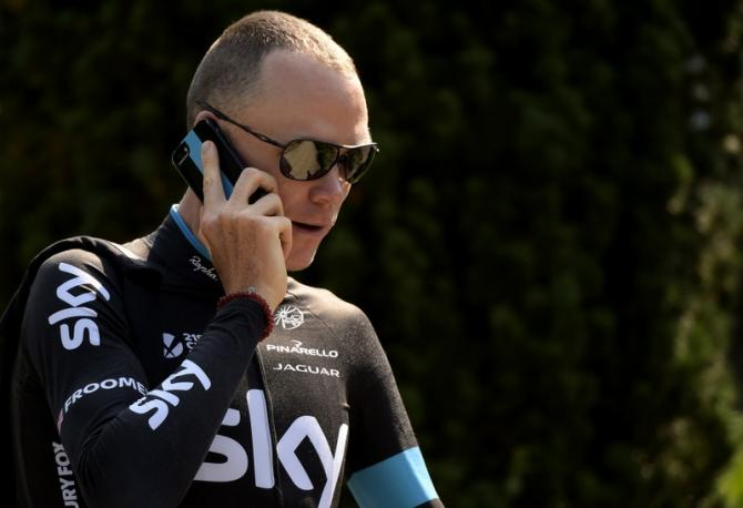 Chris Froome takes a phone call