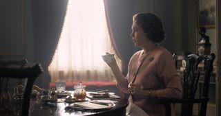 Olivia Colman enjoys tea as The Queen in The Crown season three