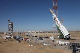 Proton rocket raised into launch position.