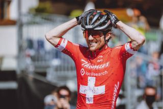 Switzerlands Mathias Flueckiger celebrates his first place of the Mens Cross Country competition of the UCI Mountain Bike World Cup in Leogang Austria on June 13 2021 Austria OUT Photo by JFK various sources AFP Austria OUT Photo by JFKEXPAAFP via Getty Images