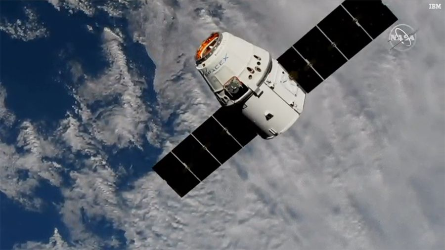 SpaceX Dragon cargo ship, the last to be caught by robot arm, arrives at space station