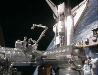 The space shuttle Discovery is shown docked with the International Space Station on Feb. 26, 2011 shortly after its arrival. A camera on the station's exterior caught this view.