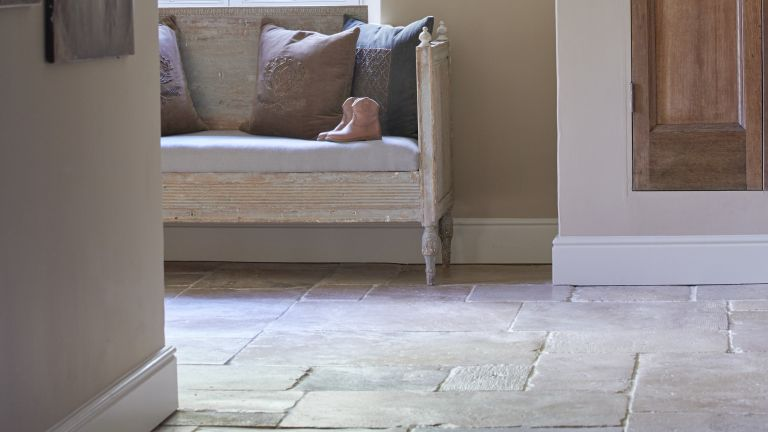 How to repair stone floors: this shows an old limestone floor