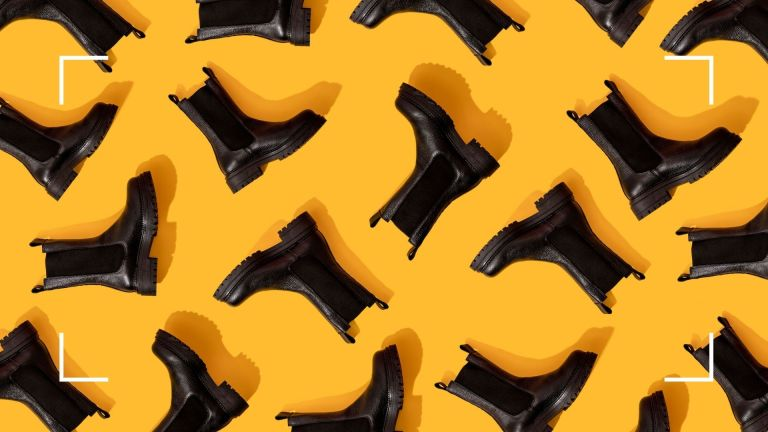 Black chunky boots arranged in a pattern on a yellow background with white corner design detail
