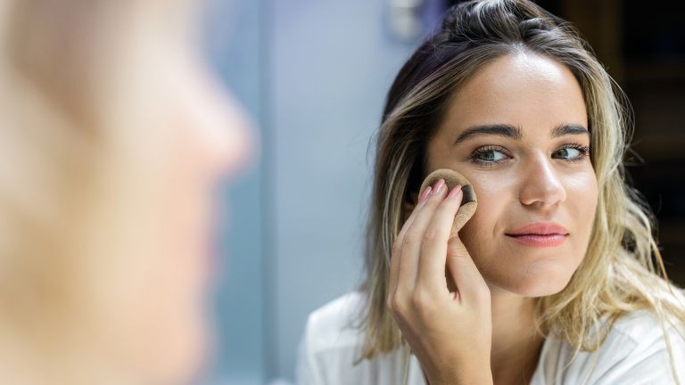 woman applying make-up with sponge