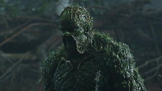 A green veined monster looms towards the camera, it's The Swamp Thing!