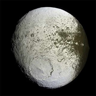 Mystery of Saturn's Two-Faced Moon Solved