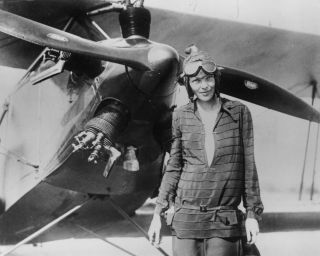 Amelia Earhart stands in front of her biplane called Friendship on June 14, 1928, in Newfoundland.