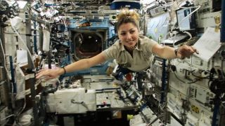 Anousheh Ansari floats through the International Space Station.