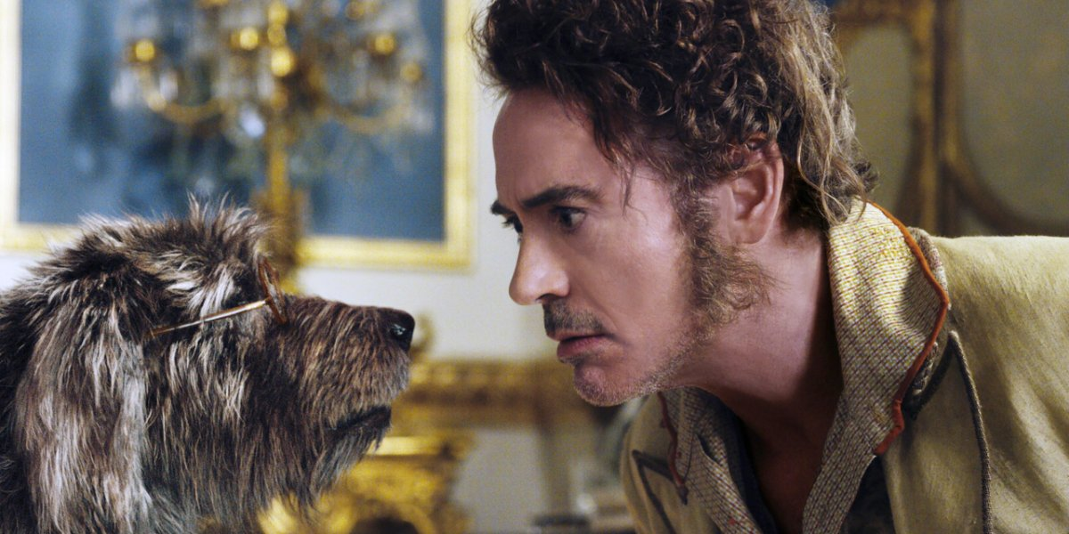 Dolittle Robert Downey Jr. looking at a dog in confusion