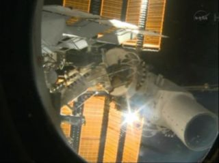 A high-resolution Urthecast Earth observation camera is seen on the exterior of the International Space Station after being installed by spacewalking cosmonauts on Dec. 27, 2013.