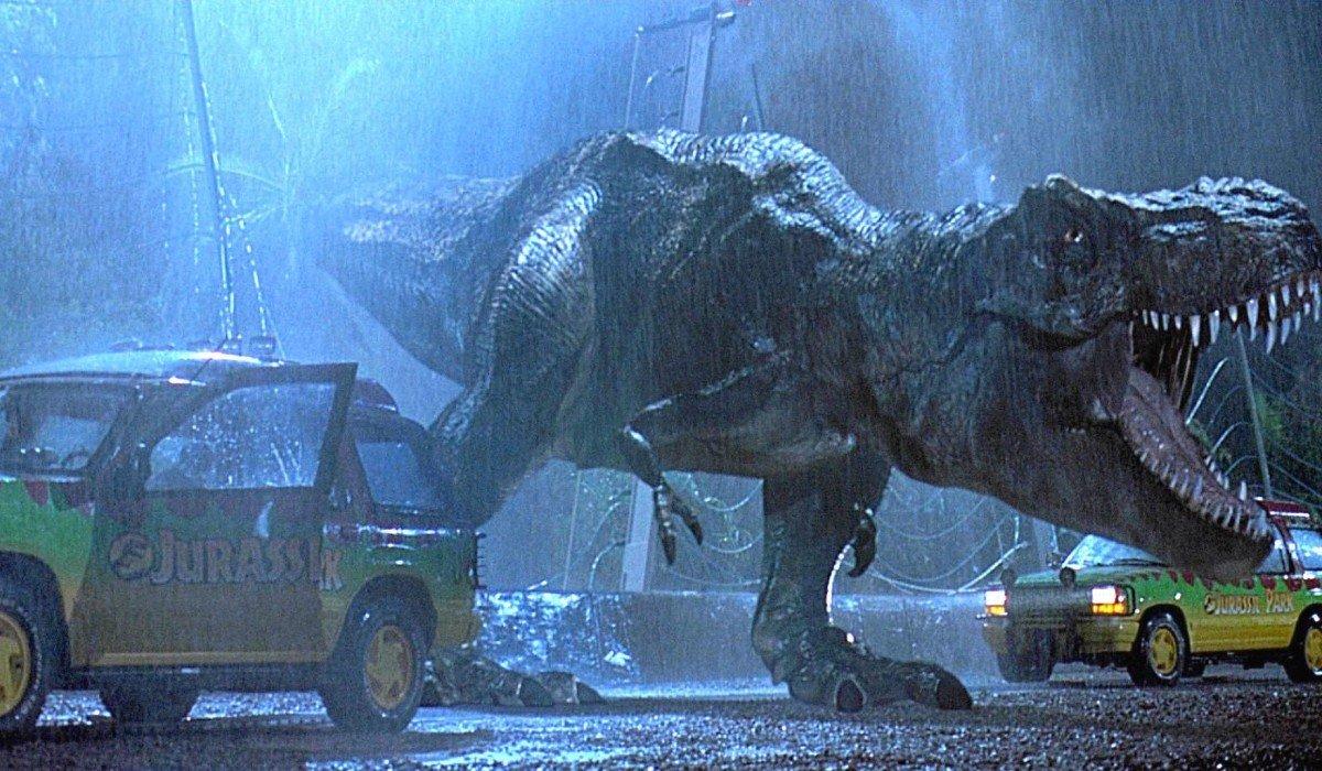 T-Rex roaring between two cars