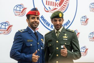 United Arab Emirates astronauts Hazzaa AlMansoori and Sultan AlNeyadi during pre-launch traditions for the Russian Soyuz vehicle.