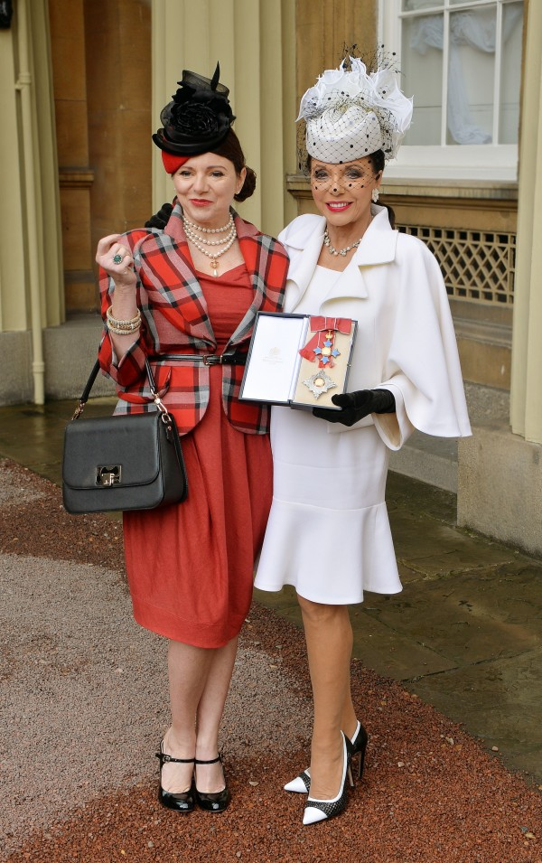 Joan Collins, right, stands with her daughter Tara Newley