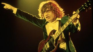 AC/DC's Angus Young performing live