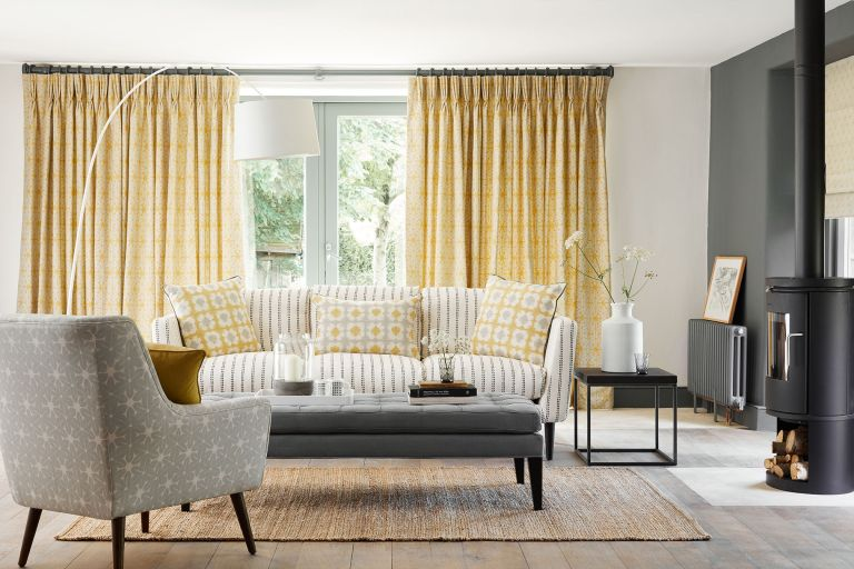 Yellow curtains in a living room by Vanessa Arbuthnott