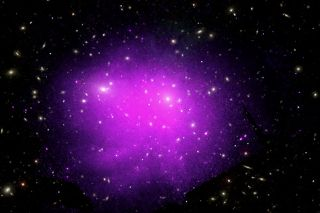 An X-ray image of the Coma galaxy cluster shows the hot gas glowing as the purple and pink colors.