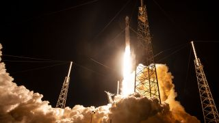 A SpaceX Falcon 9 rocket launches the CRS-17 Dragon cargo mission for NASA in May 2019. The same booster will make its fourth flight to launch SpaceX's Starlink-4 mission on Sunday, Feb. 16, 2020.