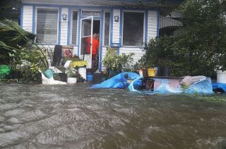 People in a neighborhood in St. Augustine, Florida, look out at the flooded street in front of their home as Hurricane Matthew passes through on Oct. 7, 2016.