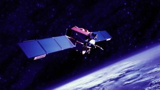 A communications satellite orbiting Earth