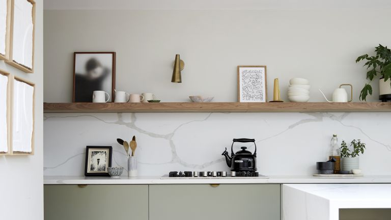 Small kitchen with open shelving and marble backsplash