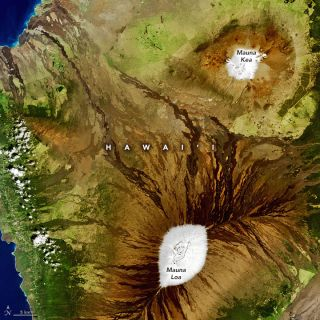 A satellite image of snow on two volcanoes on Hawaii's Big         Island.