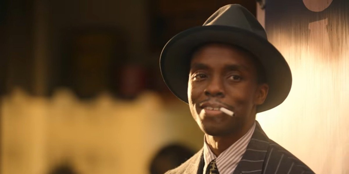 Chadwick Boseman as Levee smoking in Ma Rainey's Black Bottom