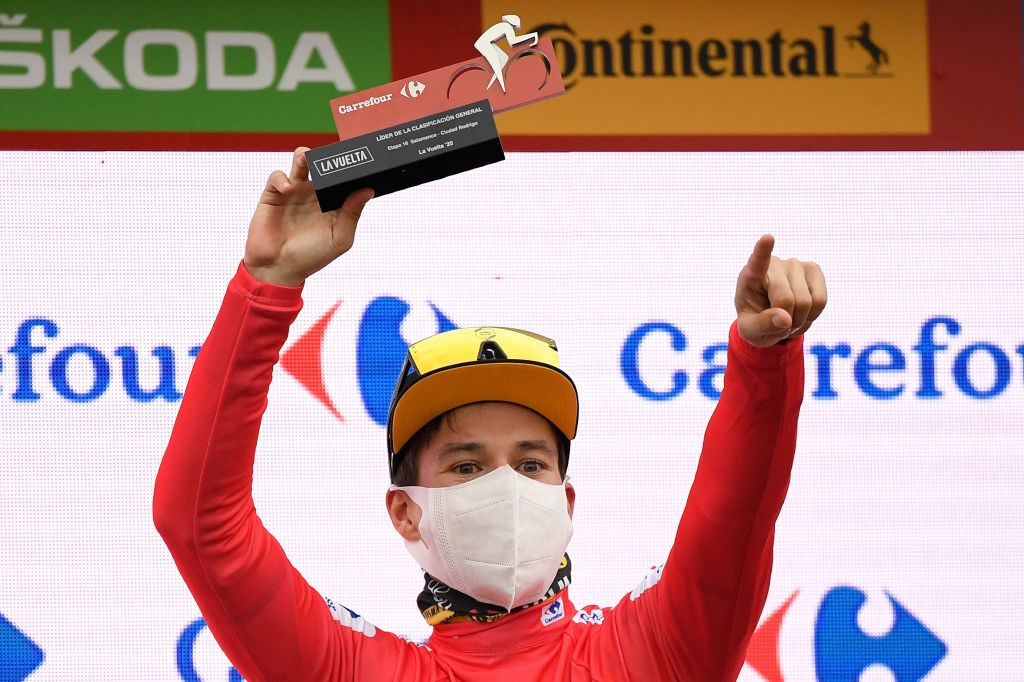 Team Jumbos Slovenian rider Primoz Roglic celebrates on the podium with the overall leaders red jersey after the 16th stage of the 2020 La Vuelta cycling tour of Spain a 162km race from Salamanca to Ciudad Rodrigo on November 6 2020 Photo by OSCAR DEL POZO AFP Photo by OSCAR DEL POZOAFP via Getty Images