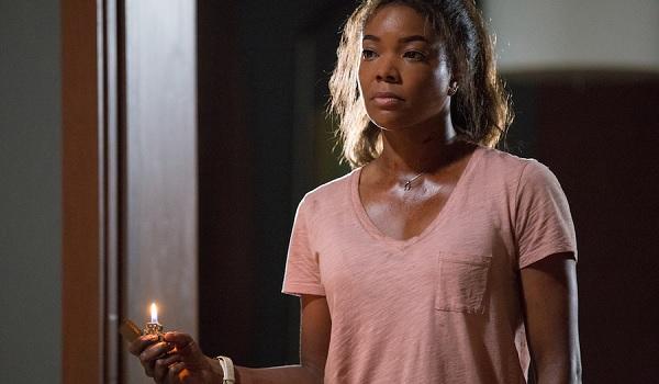 Breaking In Gabrielle Union Shaun holding a threatening lighter