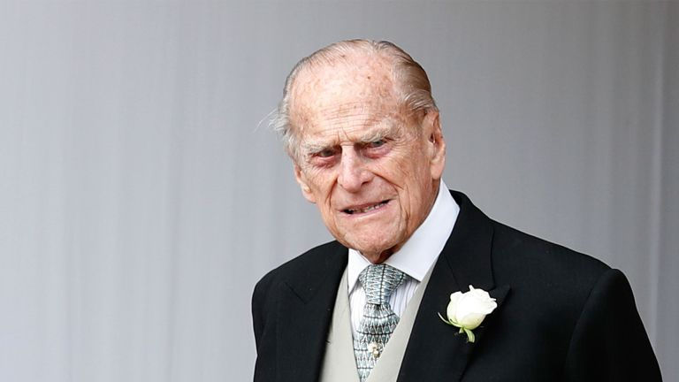 Britain's Prince Philip, Duke of Edinburgh waits for the carriage carrying Princess Eugenie of York and her husband Jack Brooksbank to pass at the start of the procession after their wedding ceremony at St George's Chapel, Windsor Castle, in Windsor, on October 12, 2018. (Photo by Alastair Grant / POOL / AFP) (Photo by ALASTAIR GRANT/POOL/AFP via Getty Images)