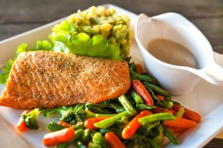 A Mediterranean diet meal of fish and vegetables.